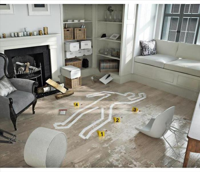 Living room with furniture and contents with white tape placed as an out line of a body after a crime scene