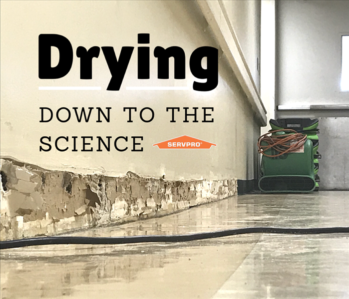 "drying equipment in a affected room with a written slogan ""Drying down to a science"""